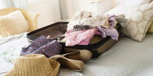 landscape-1462475952-suitcase-on-bed