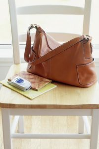 gallery-1457459206-spring-cleaning-purse